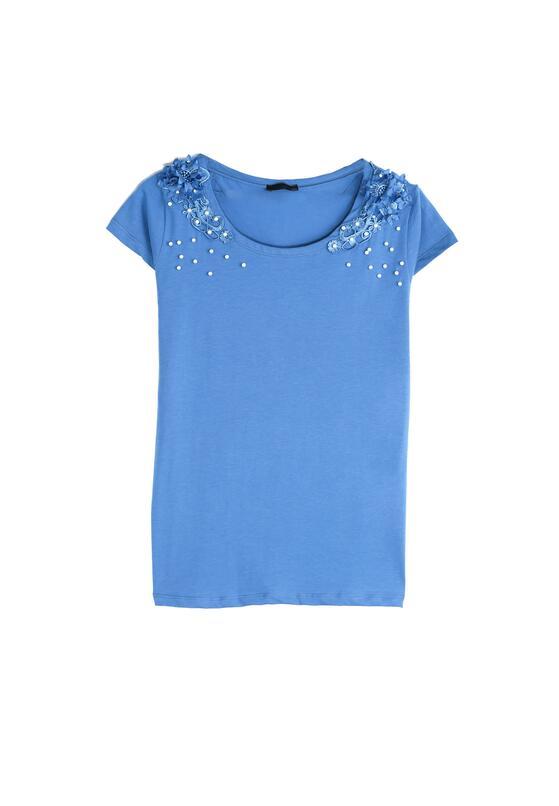 Niebieski T-shirt Comes Tumbling