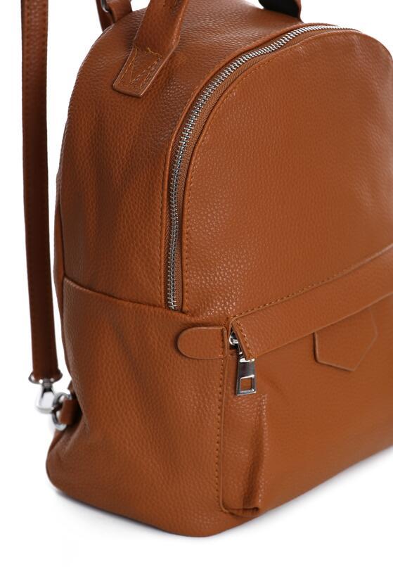 Brązowy Plecak Examines