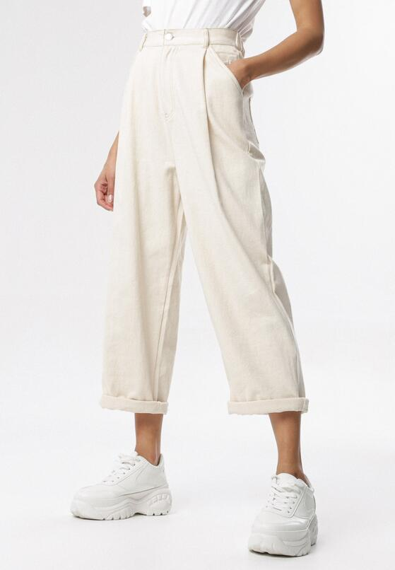 Kremowe Spodnie Dorymene