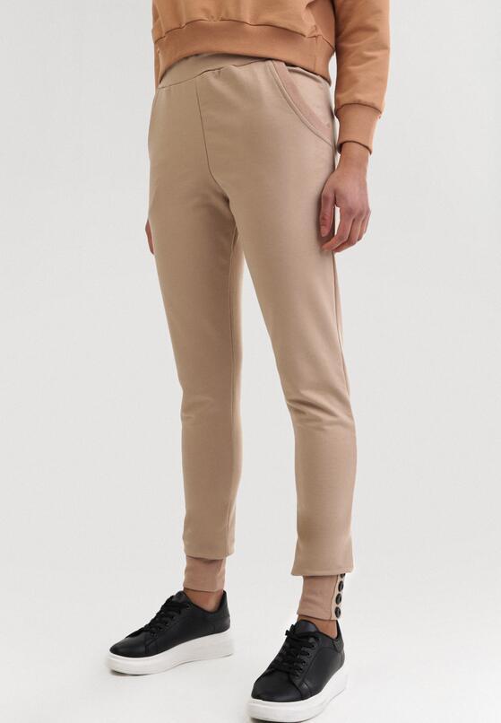 Jasnobeżowe Spodnie Dresowe Uhrlenne