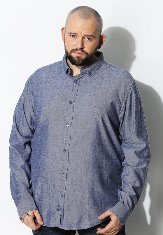 Niebieska Koszula Decided