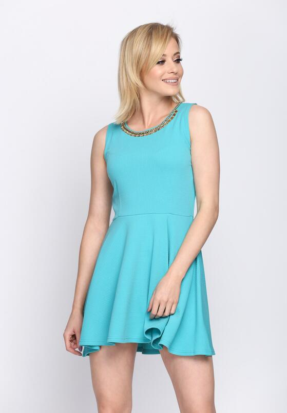 Niebieska Sukienka Evolving