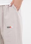 Jasnobeżowe Spodnie Theaneleia