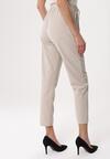 Jasnobeżowe Spodnie Deficiency